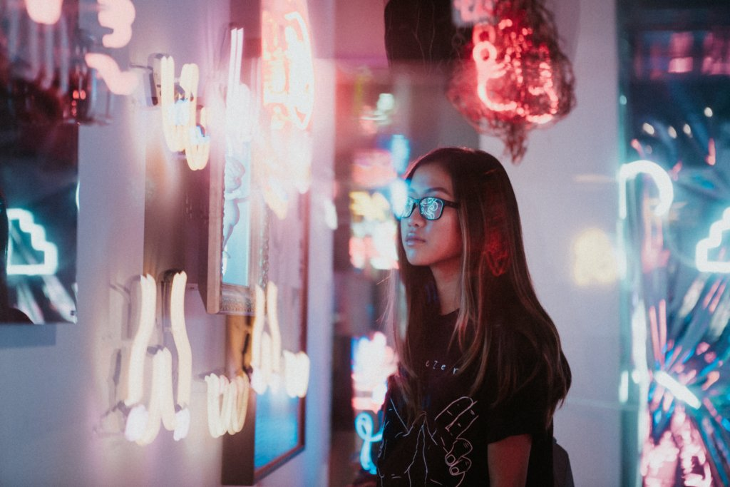girl staring neon lights Blue Monday, facto or fiction?